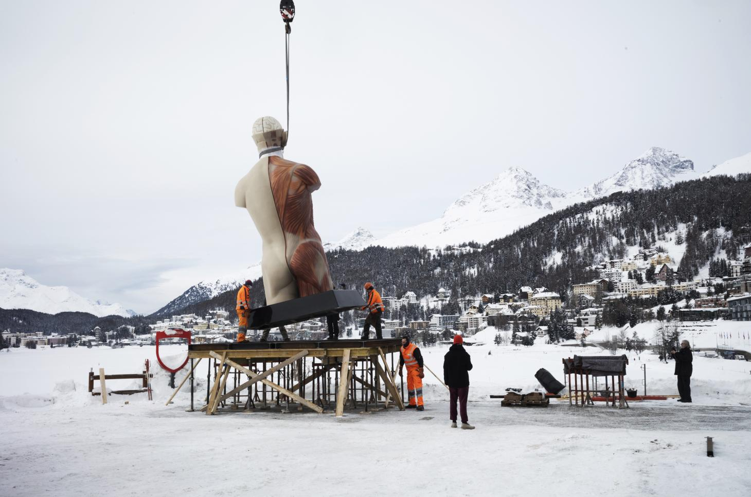 Photograph of Damien Hirst's Temple sculpture being installed on Lake St. Moritz