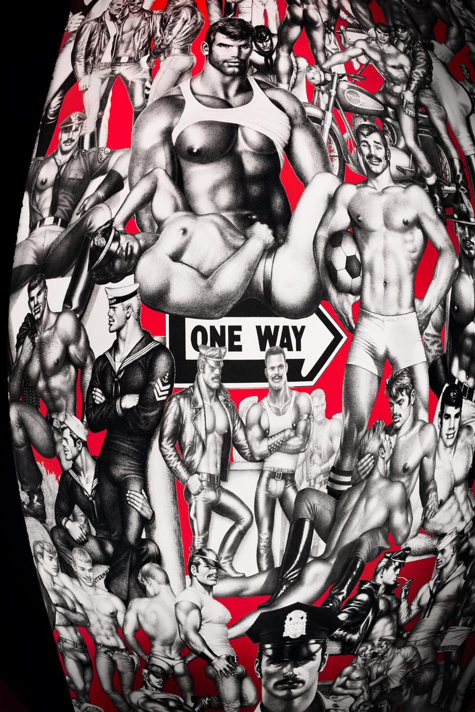 Tom of Finland TAME wallpaper in Fotografiska Red by Flavor Paper. Designed by Tom of Finland, Michael Reynolds and Hoffman Creative. Exclusively at The Shop at Fotografiska