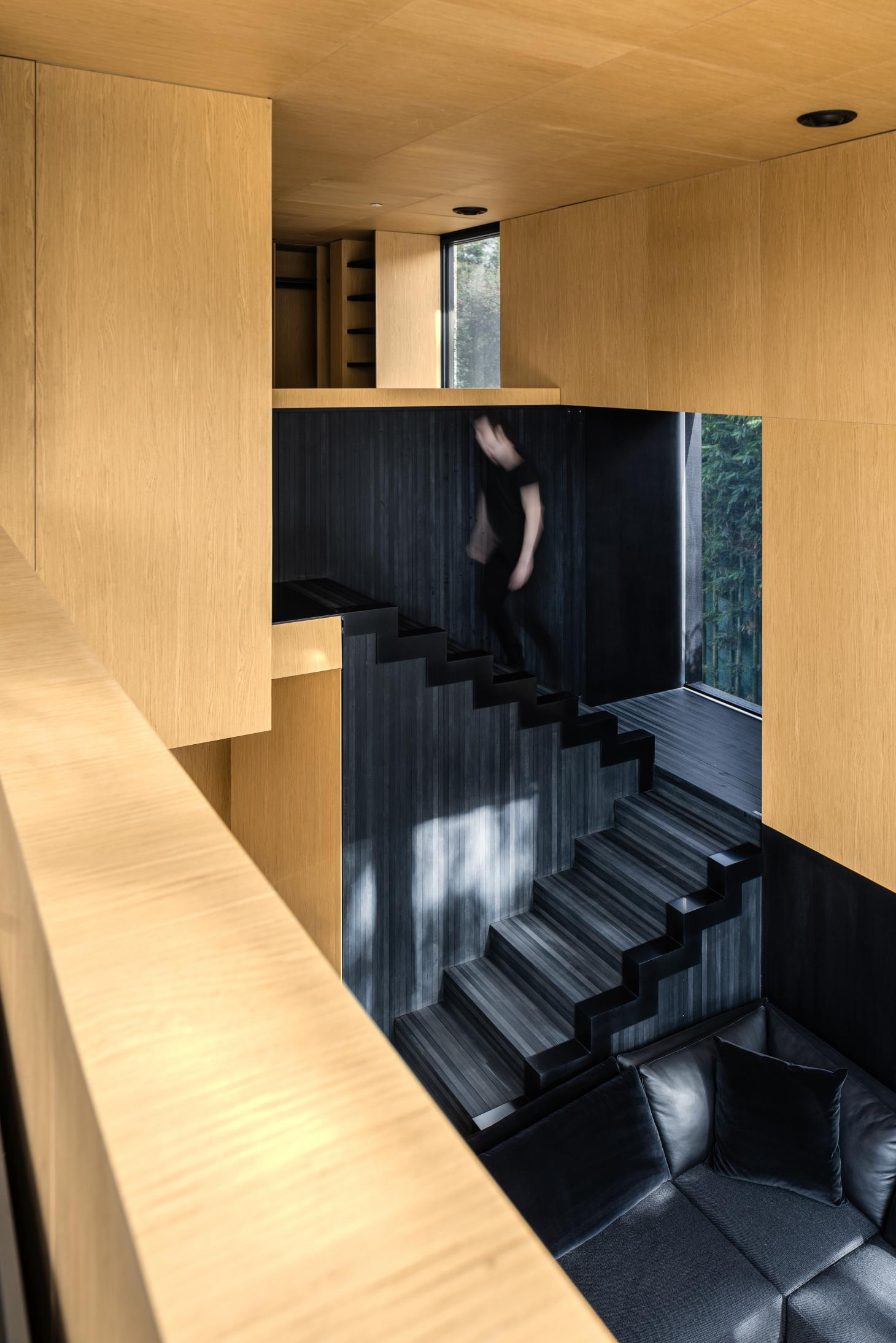 dramatic staircase at Miguel Ángel Aragonés metal prefab house in Mexico