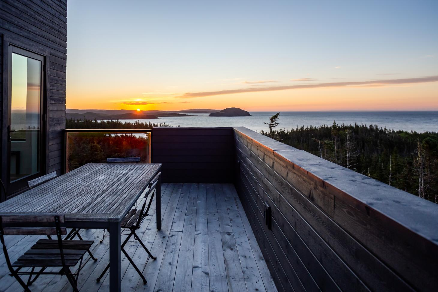 The upper deck at the Halfway Hill House by Woodford Architecture