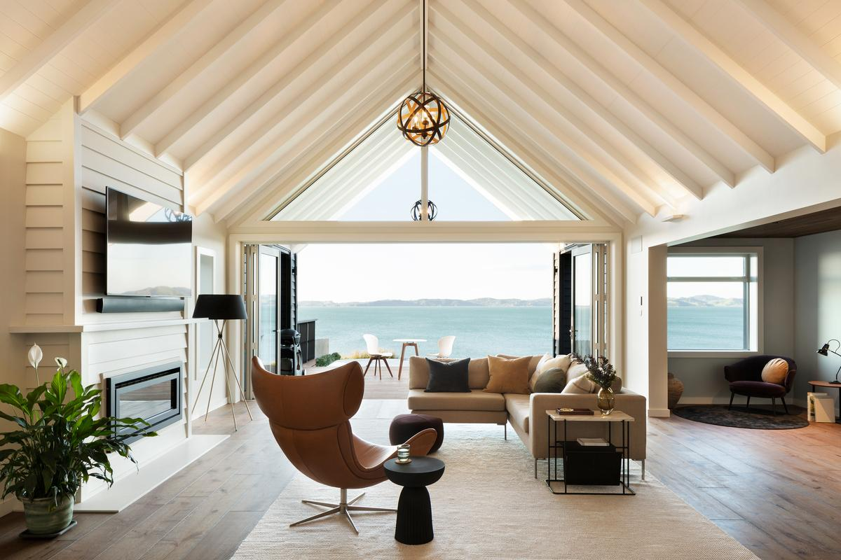 pitched roof beach house in Auckland looking out into the sea