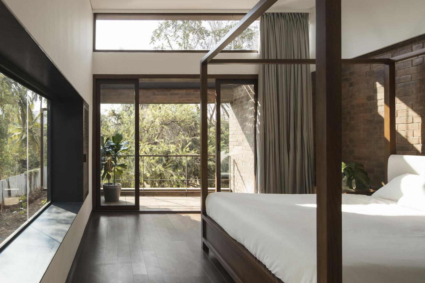 Brick House features large openings looking out to the greenery