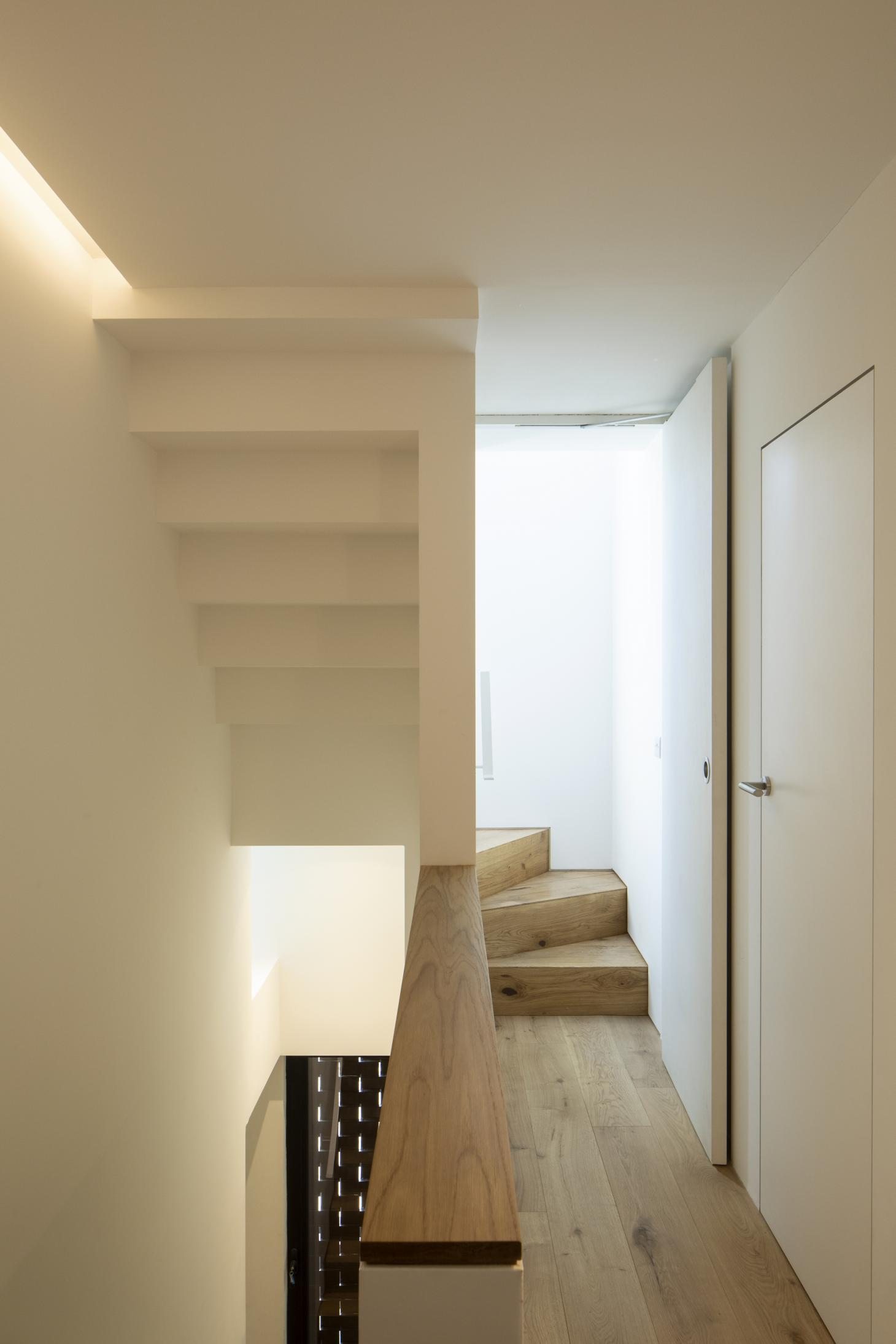 sculptural wooden staircase in London apartment