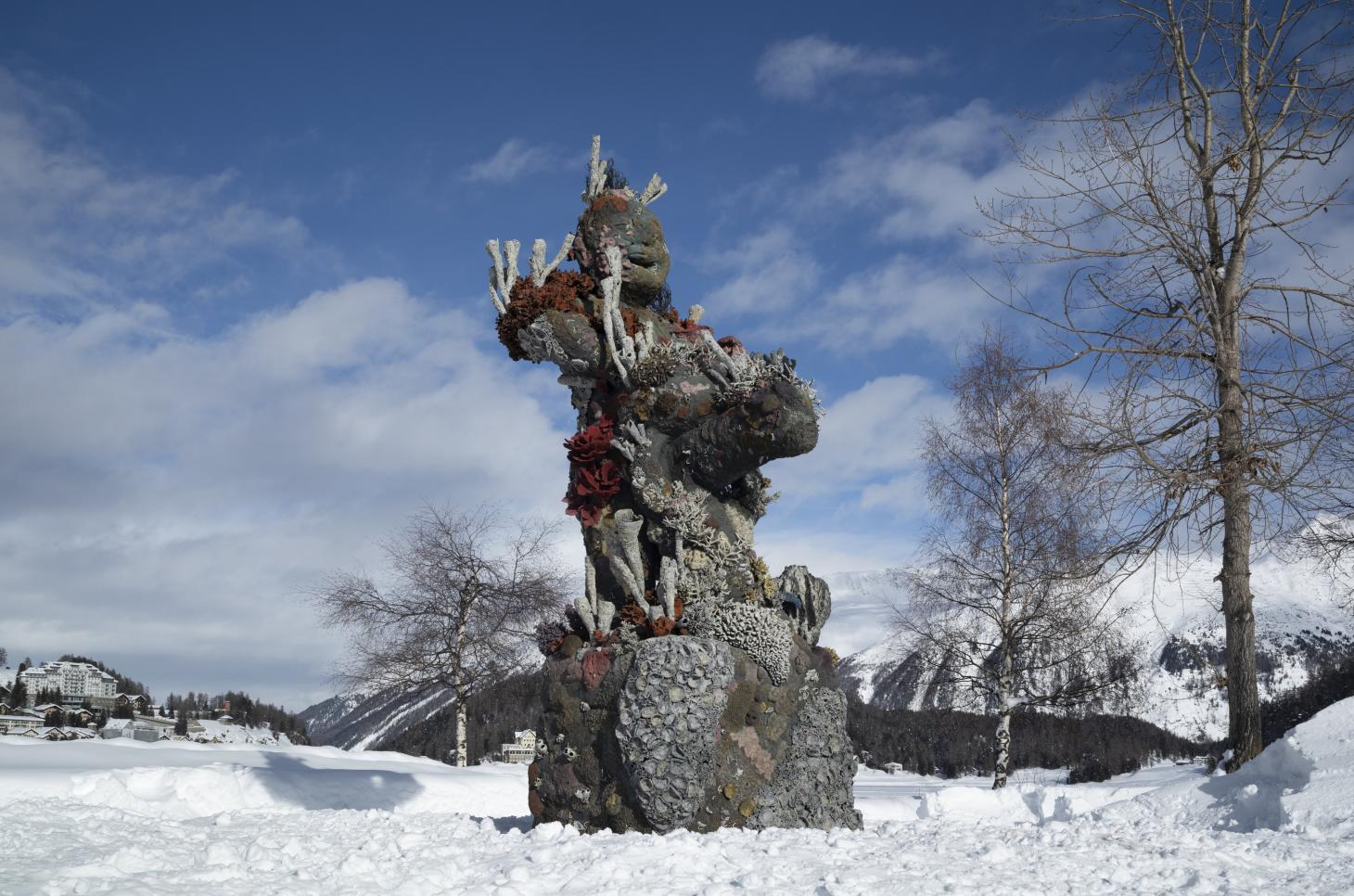 Photograph of Damien Hirst's Two Figures With A Drum sculpture installed in St. Moritz