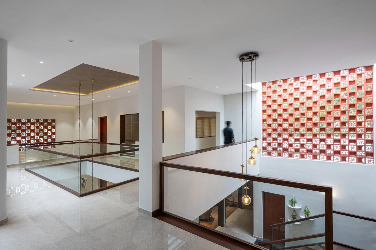 hero shot of the central circulation space with jaali screens at The Manjeri Residence in India