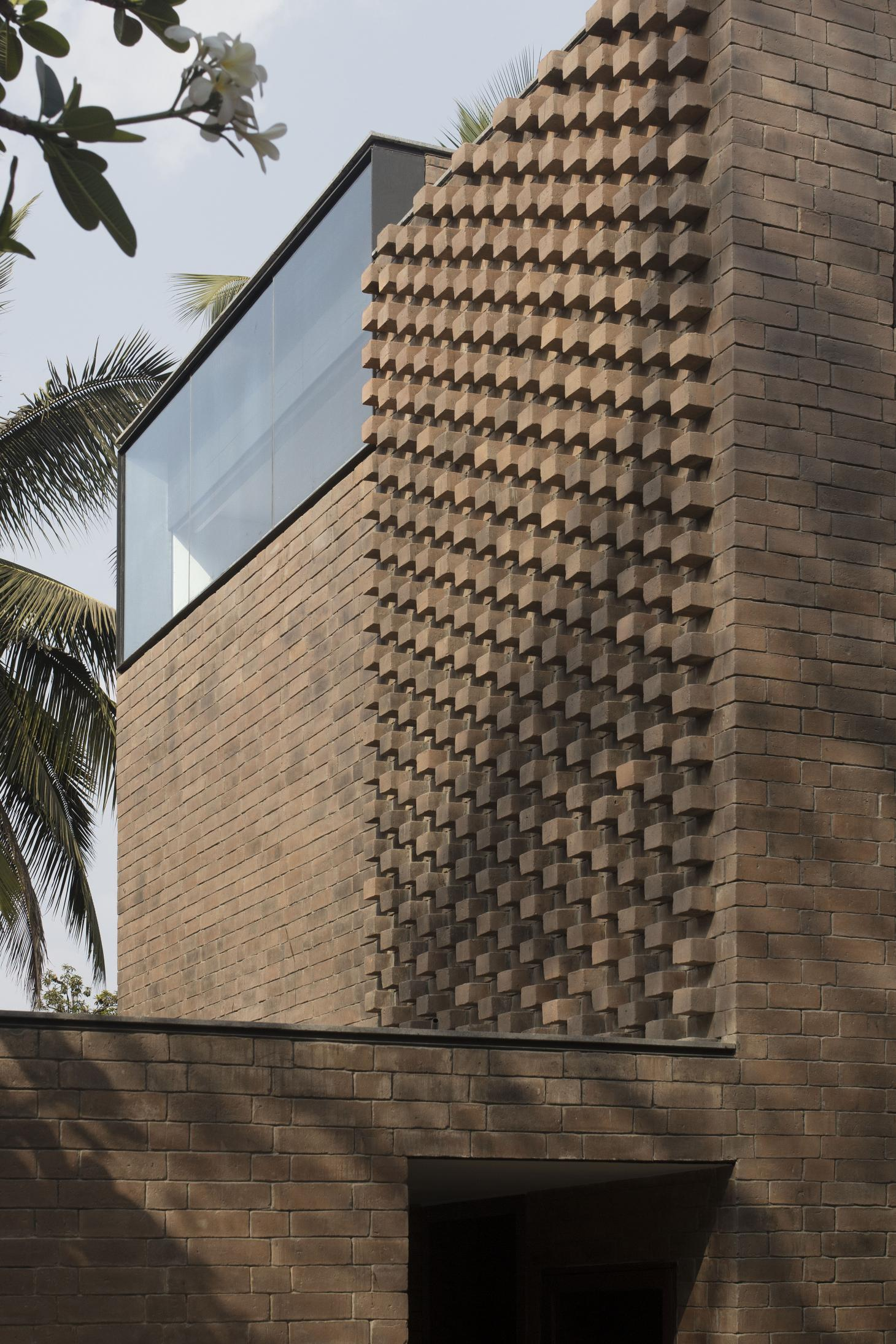 clever brickwork and openings define the facades of Brick House