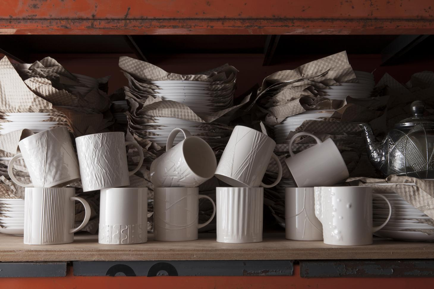 White ceramic cups with textured surfaces by Martino Gamper