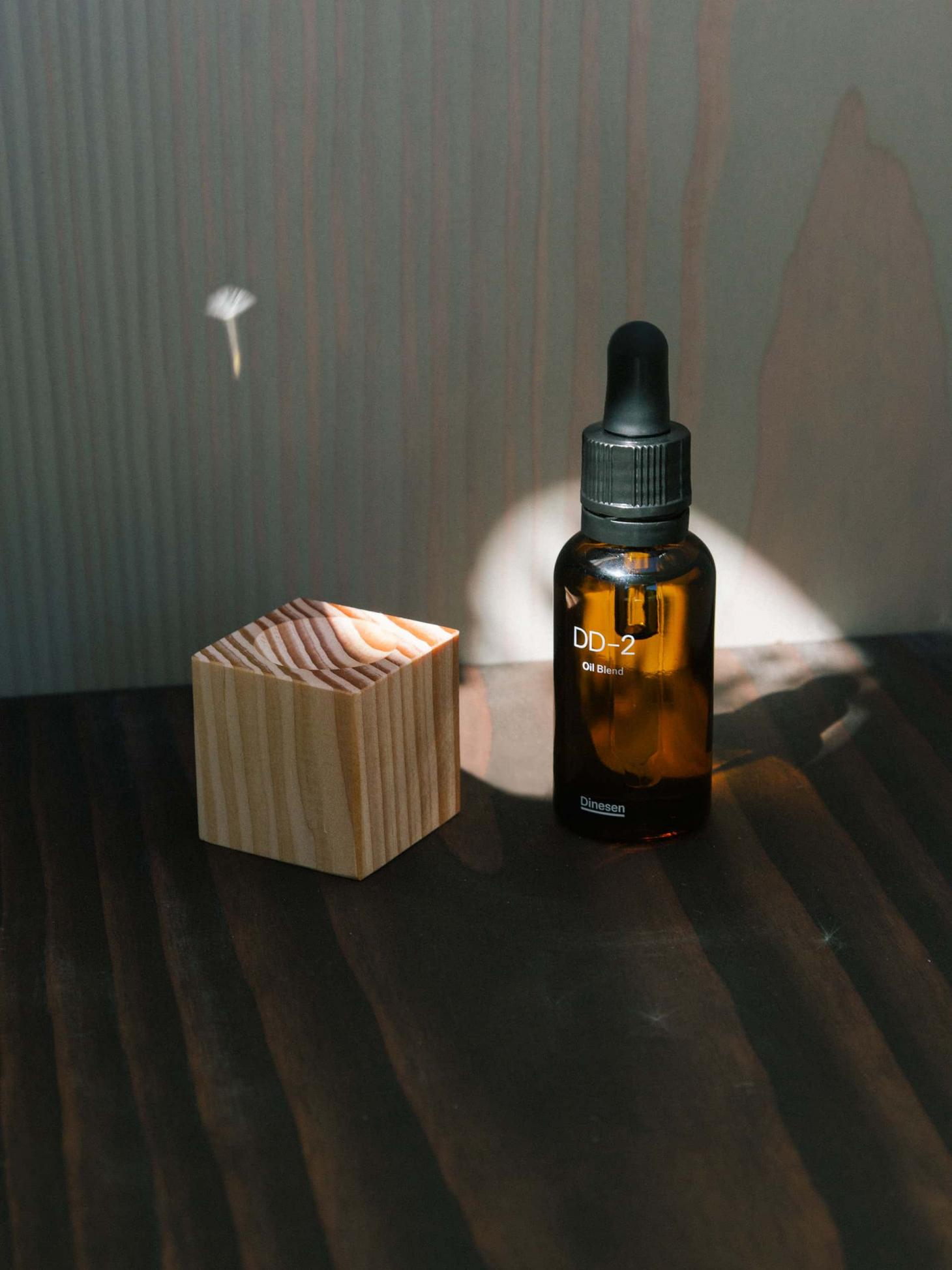 DD-2 tincture against a wooden wall