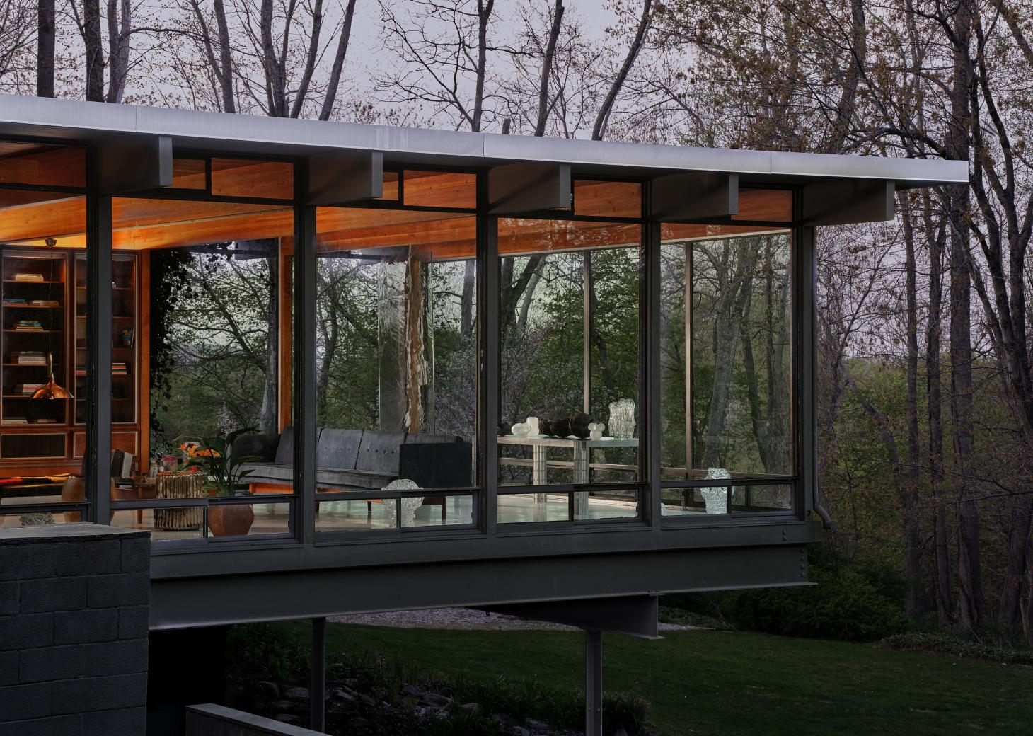 Exterior shot of glass and steel modernist house by Gerald Luss