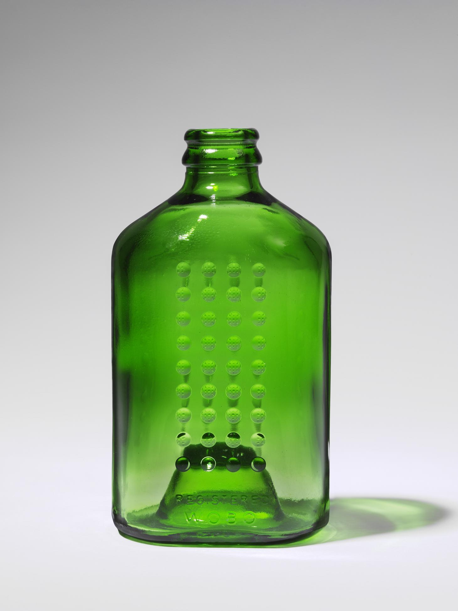 Green glass bottle in the shape of a brick