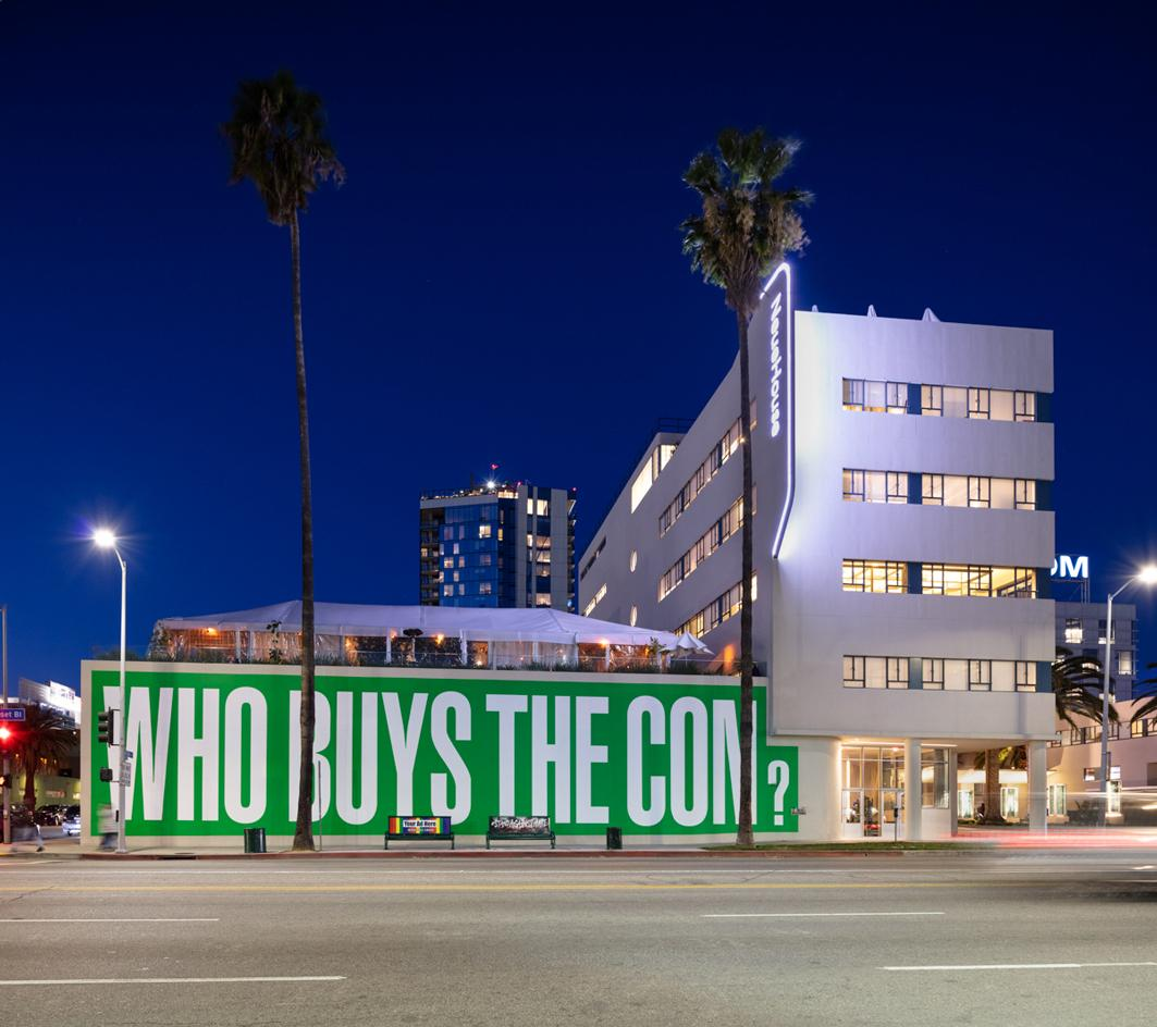 Barbara Kruger's 'Who Buys The Con' installation on NeueHouse Hollywood façade during Frieze LA