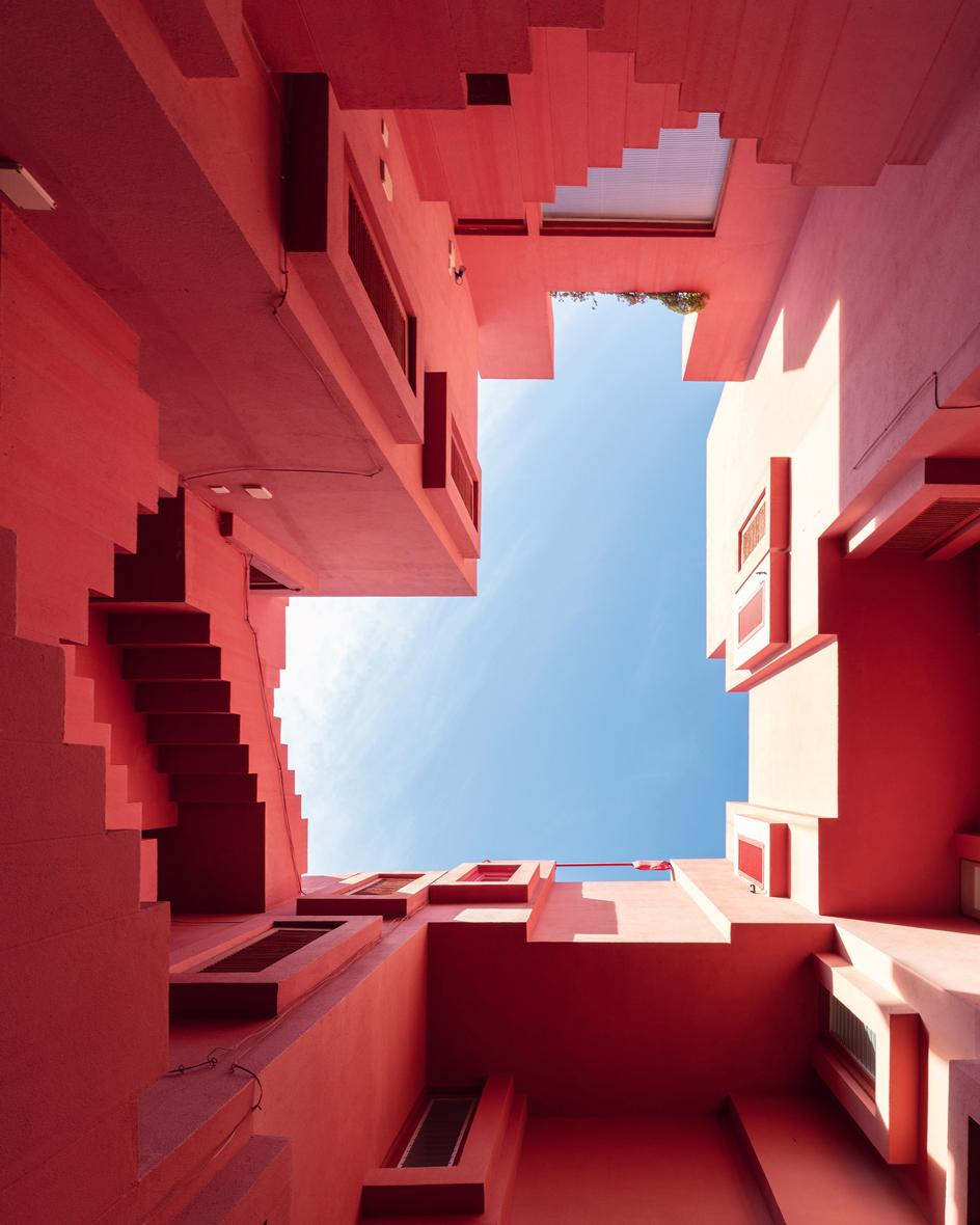 Upward view of Sebastian Weiss' photo series on Ricardo Bofill's 'La Muralla Roja' in Calp, Spain