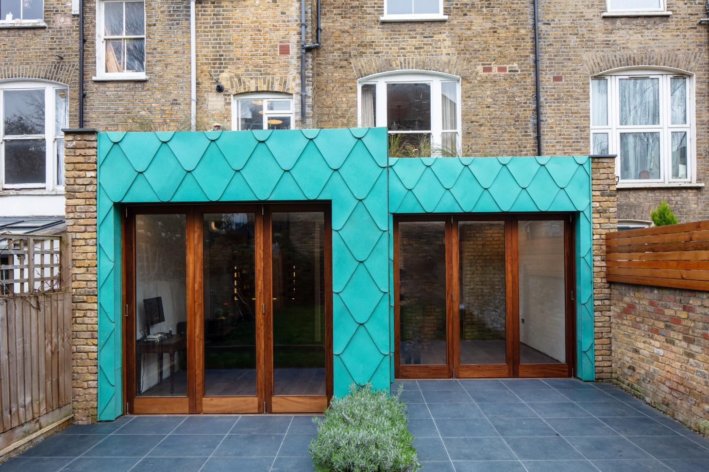 green copper tiles clad this London house extension