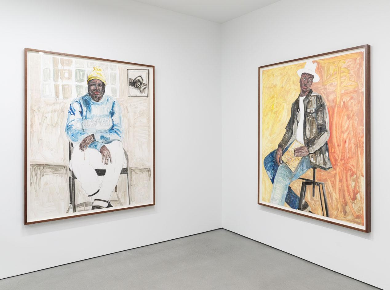 Installation view of Serge Attukwei Clottey's'Beyond Skin' featuring a row of new painted portraits at Simchowitz Gallery, Los Angeles