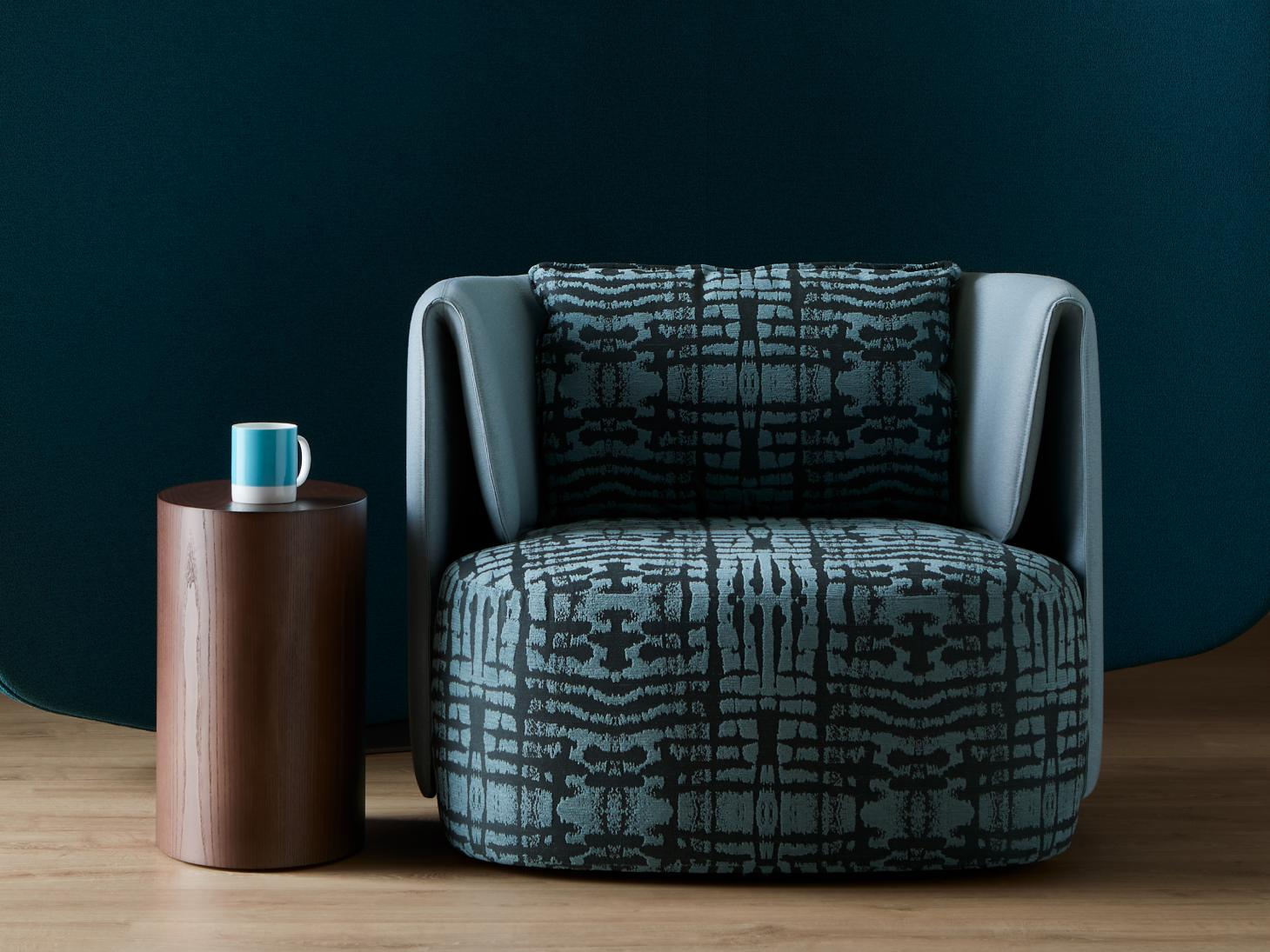 Armchair upholstered in blue patterned fabric by Bernhardt Design
