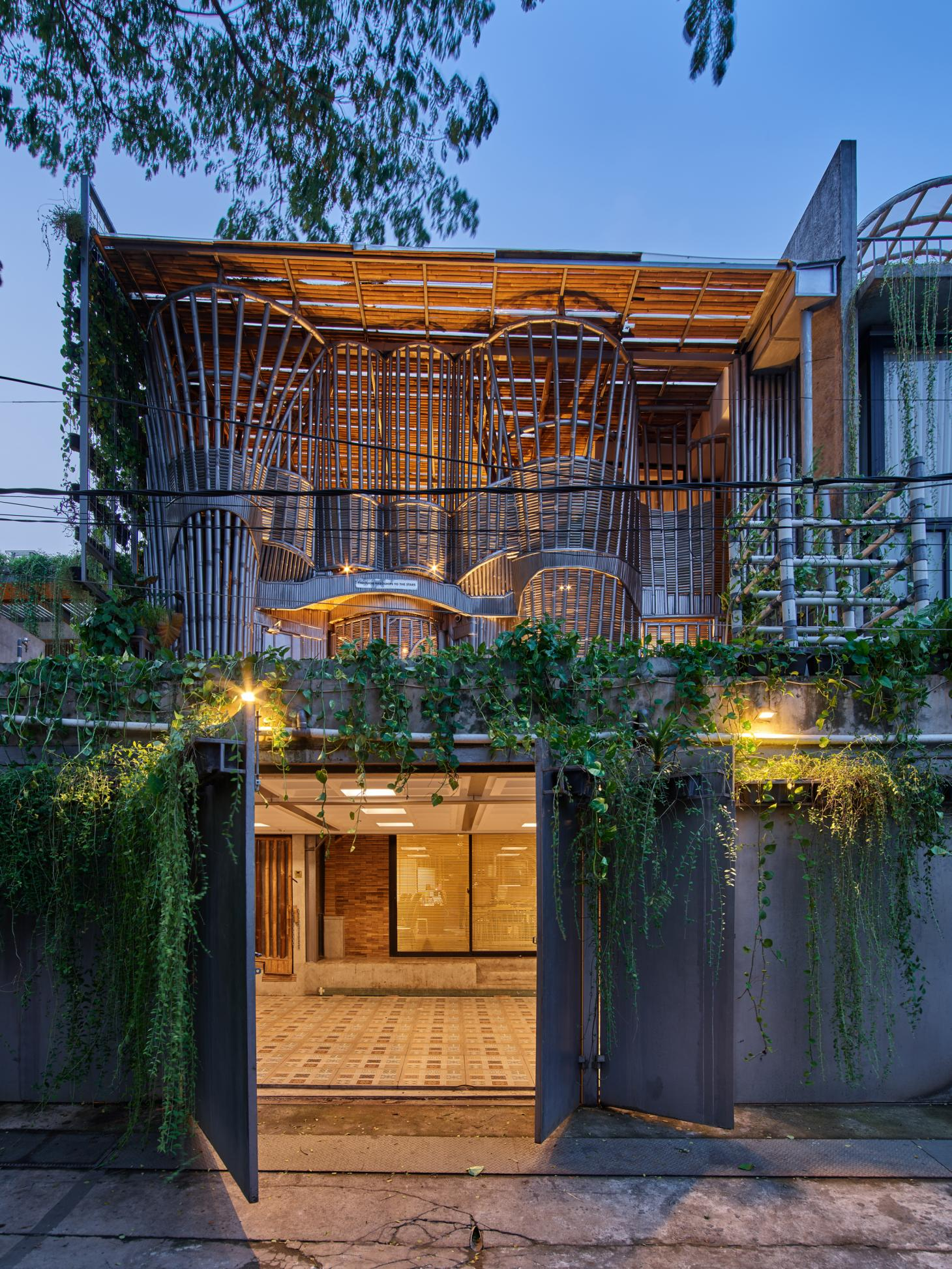 concrete, bamboo and nature mix at RAW architecture's live/work space, seen here the entrance