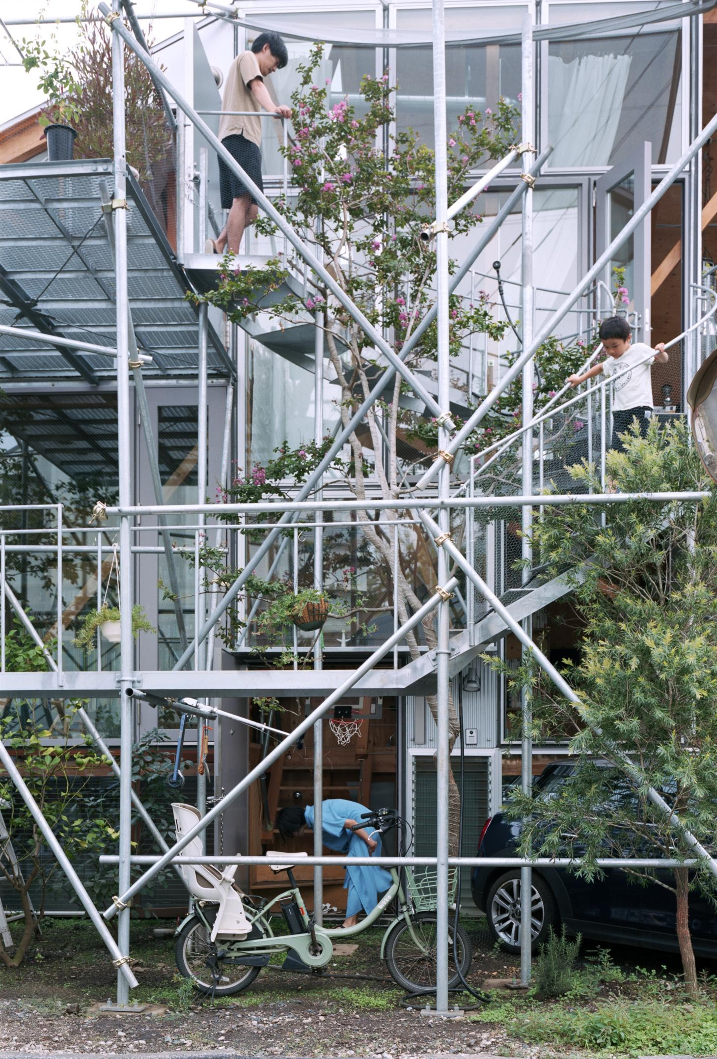 Daita20219's facade blends scaffolding-style structures, glass and planting