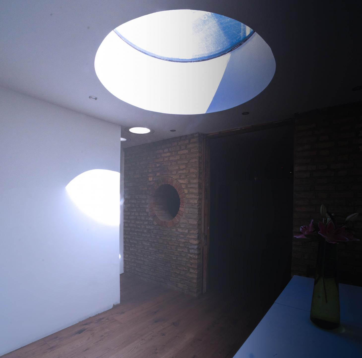 round skylight in Green House extension in London