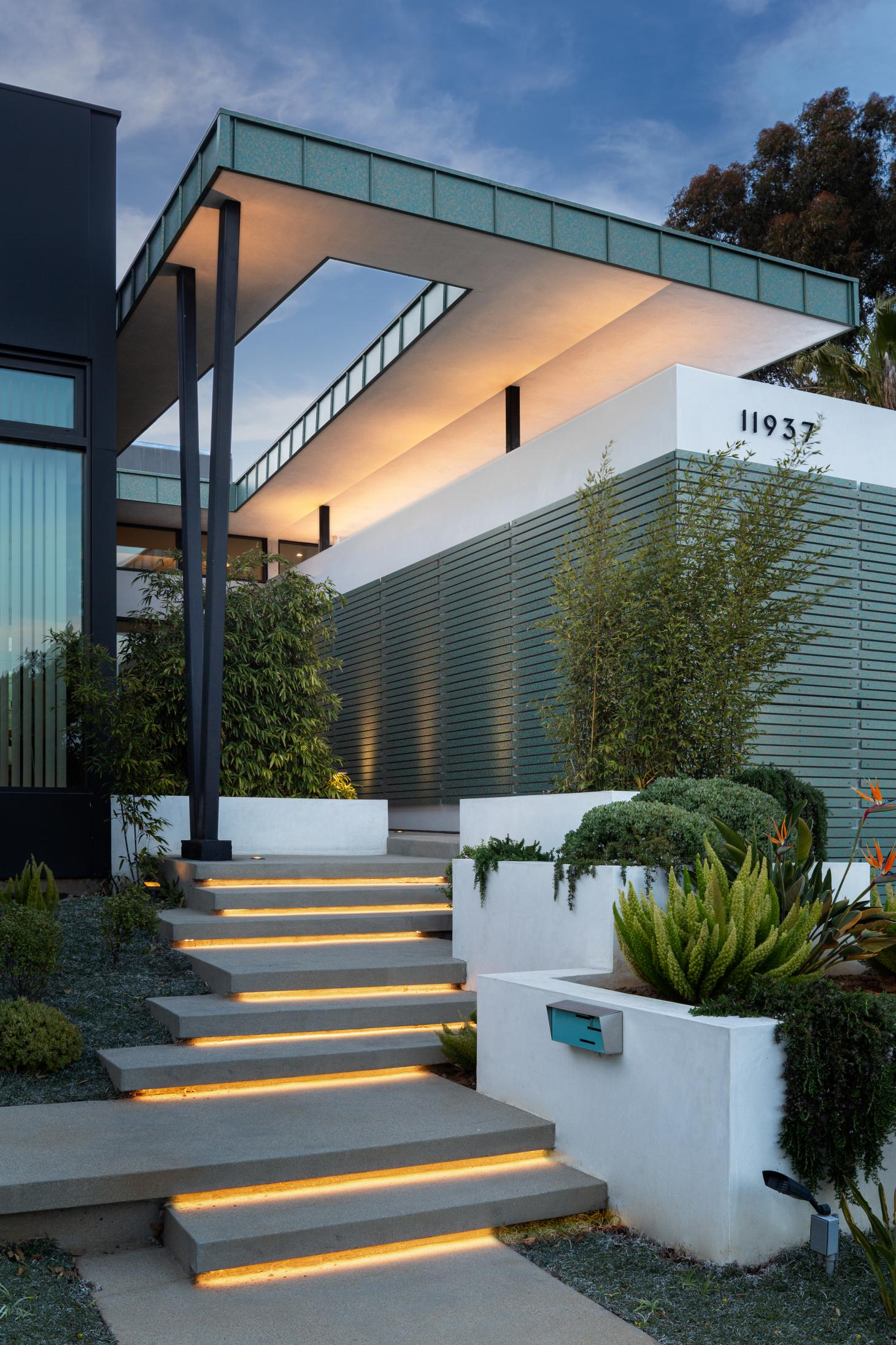 dramatic night view of front entrance at Mar Vista Residence by Tim Gorter Architect