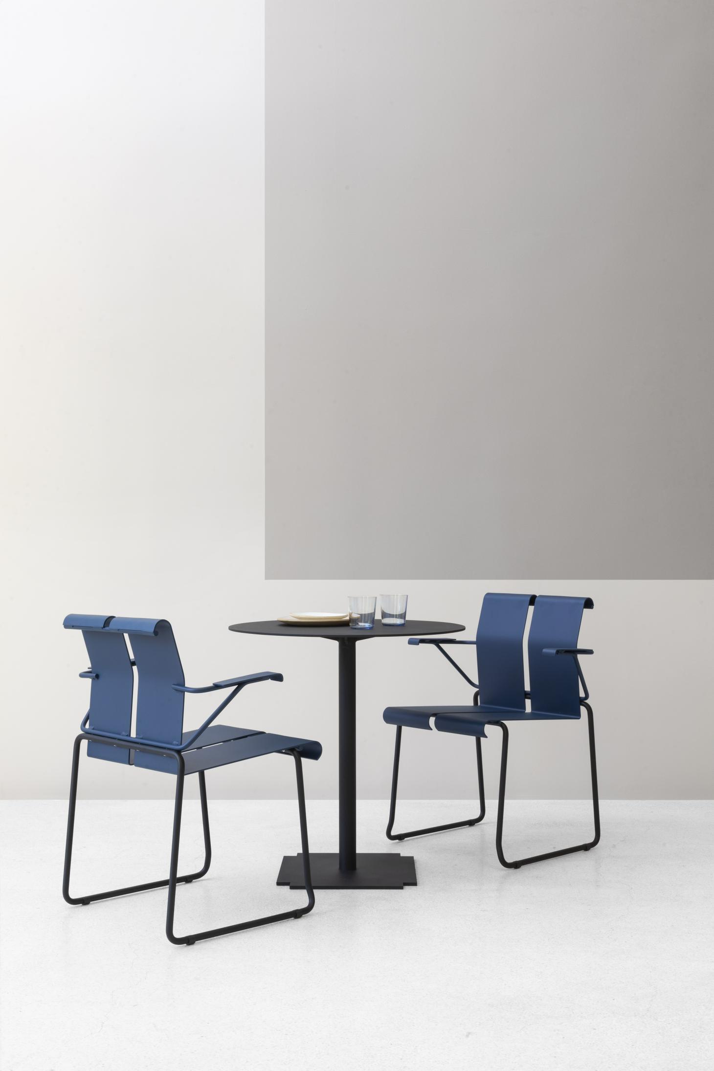 Small bistrot table with two blue dining chairs