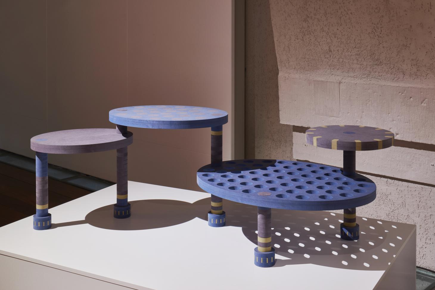Tables installation made of wood from Finsa, part of Designers in the Middle exhibition at London Design Biennale