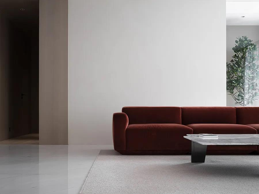minimalist living room with red sofa at red box house in China