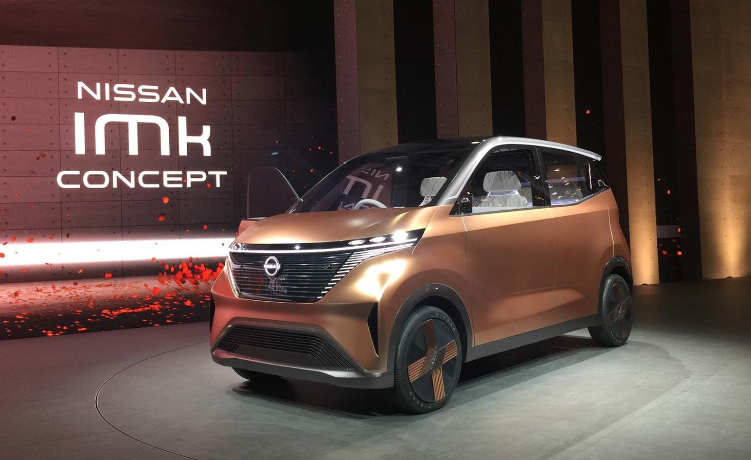 A Nissan IMk sits in a showrom