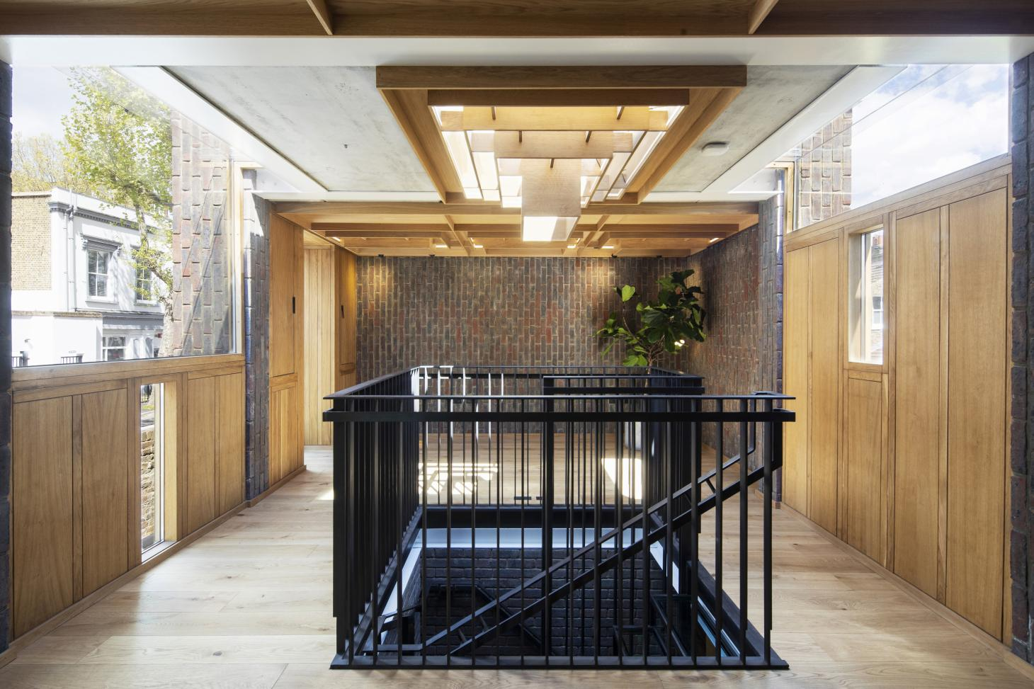 interior showing central metal staircase at Southwark brick house by Satish Jassal