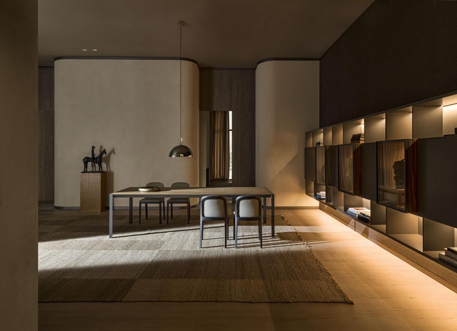 Dining room featuring Jasper Morrison's chair for Molteni with a curved back and black wood structure