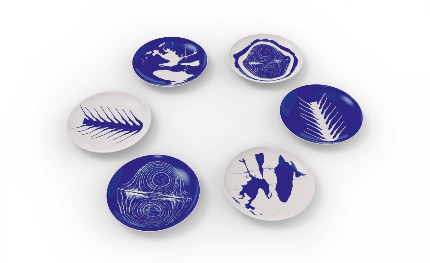 Blue and white plates in a circle