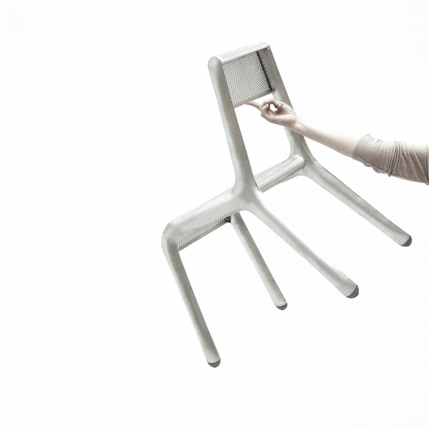 Holding the ultralight recycled aluminium chair with one finger