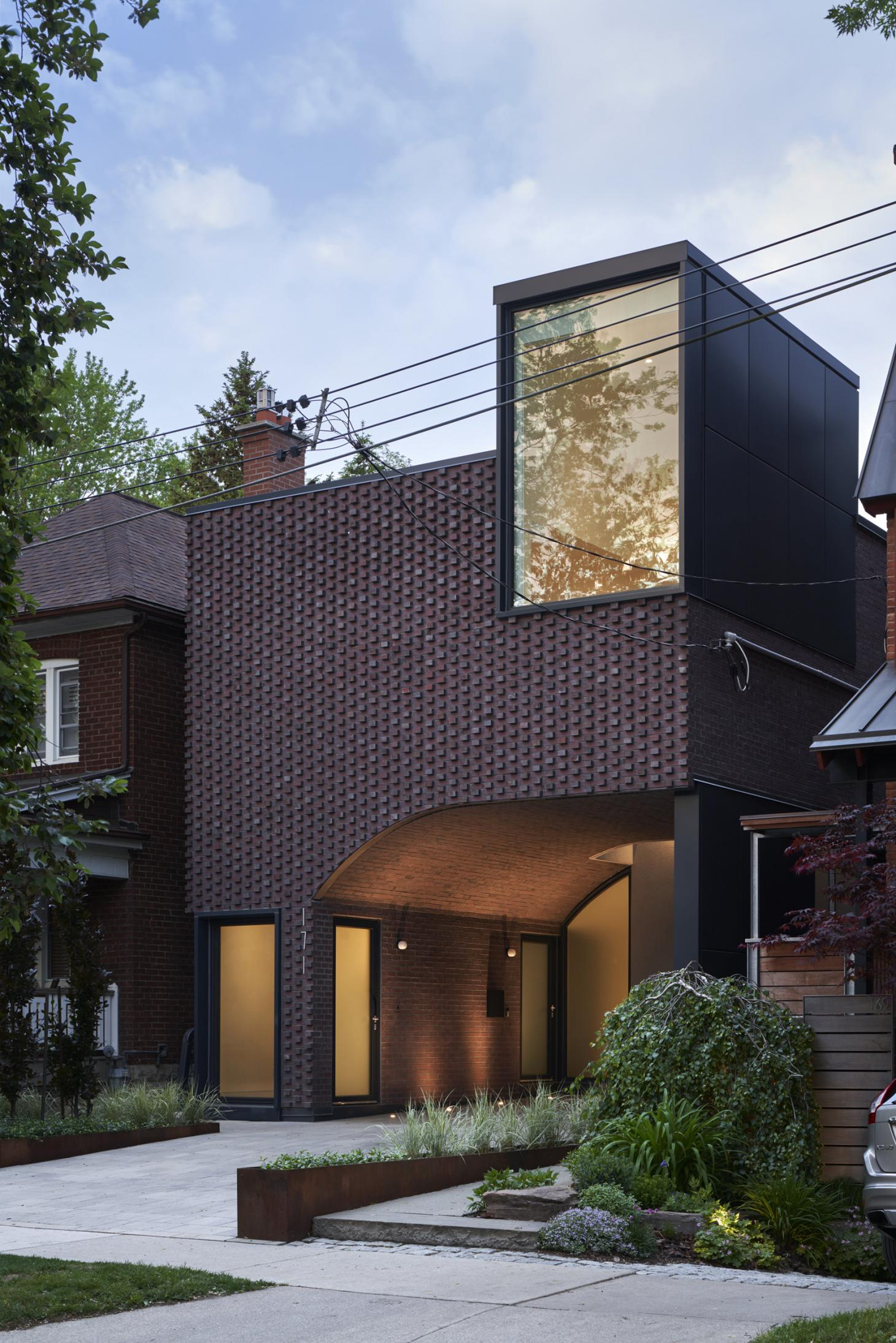 The brick facade fits into the existing streetscape