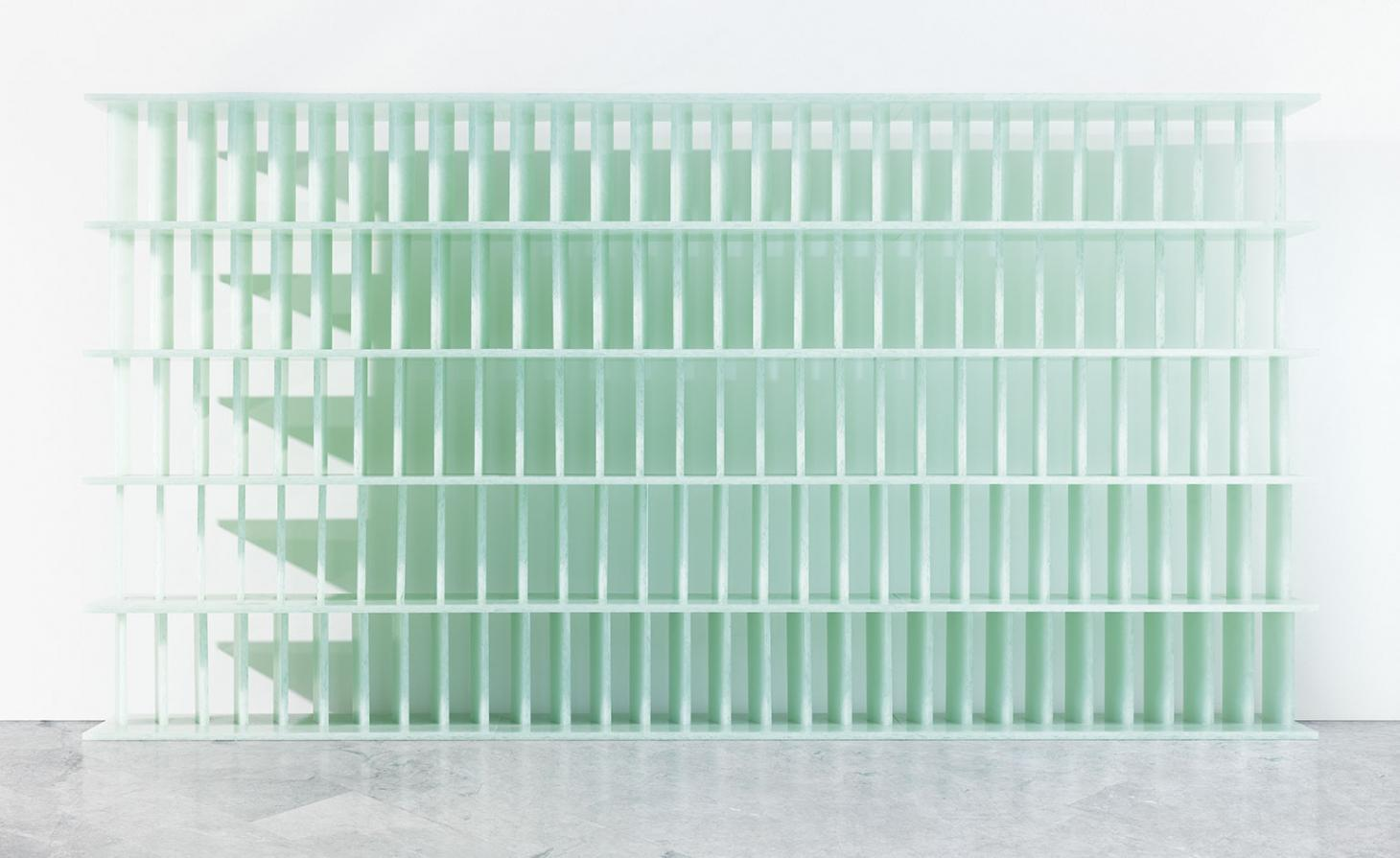 bookshelf made of recycled material in seafoam green
