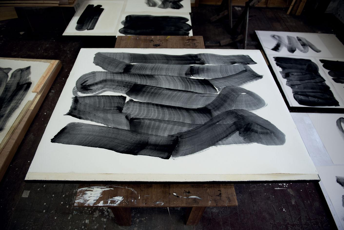 Lee Bae charcoal artwork lies in a studio
