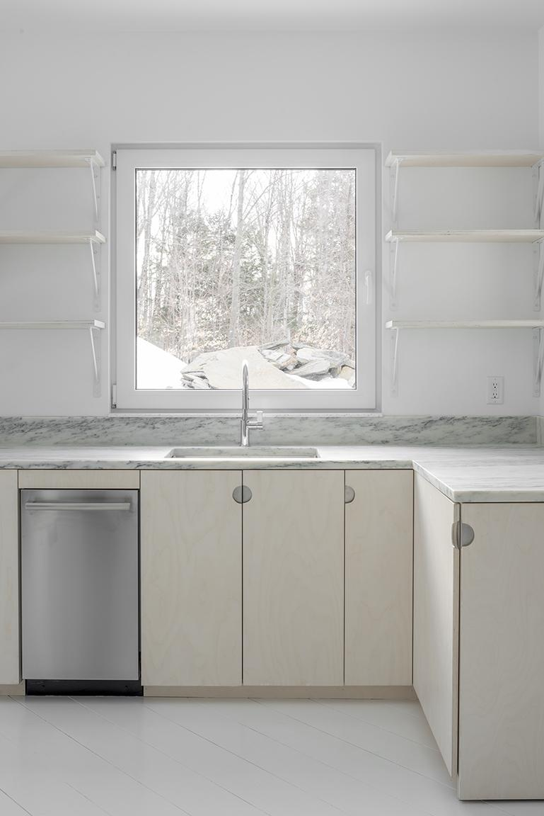 kitchen with soft colours in minimalist Vermont cabin