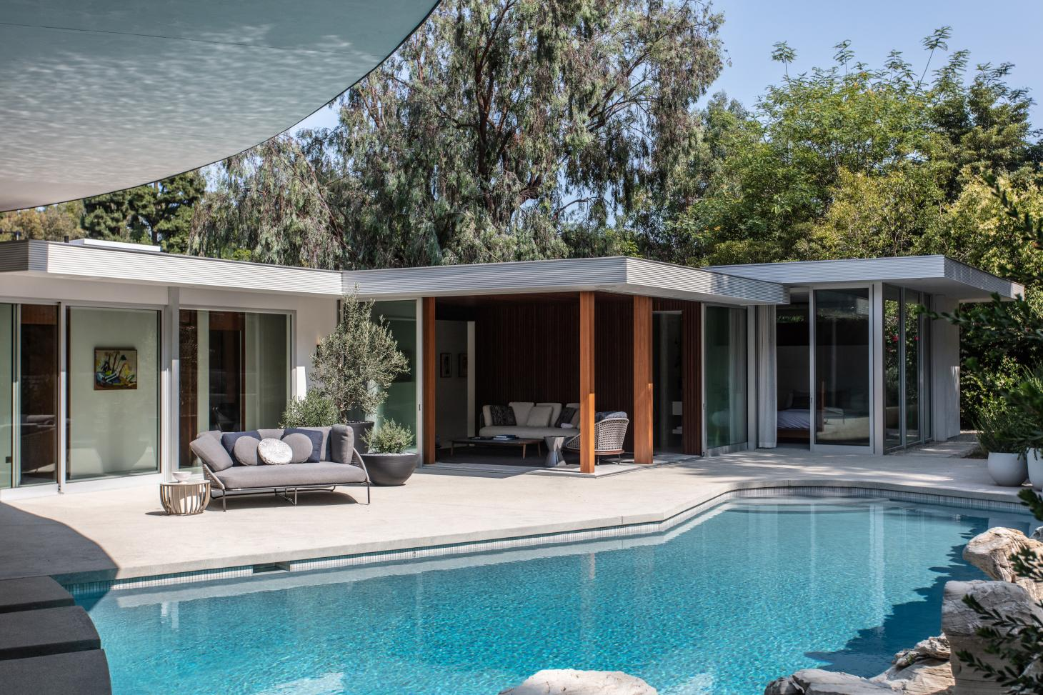 exterior with pool of cove way, a midcentury home restored by Sophie goineau