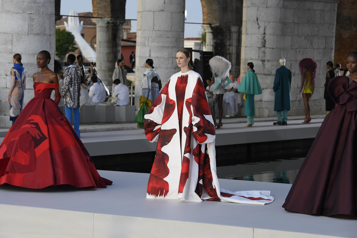 Model wears a red gown at Valentino A/W 2021 Haute Couture show