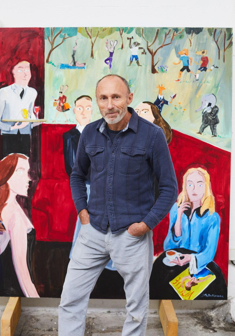 Jean-Philippe Delhomme stands in front of the other of his two murals forCarlyle & Co., titledYou, the Night, and the Music in the French artist's Paris studio