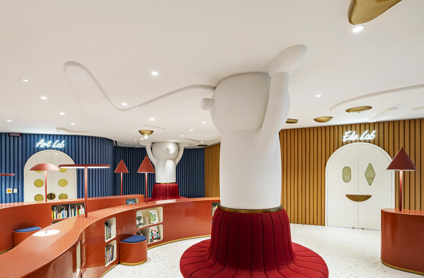 View of MOKA Library by Jaime Hayon, with a pillar transformed into a giant figure holding up the ceiling