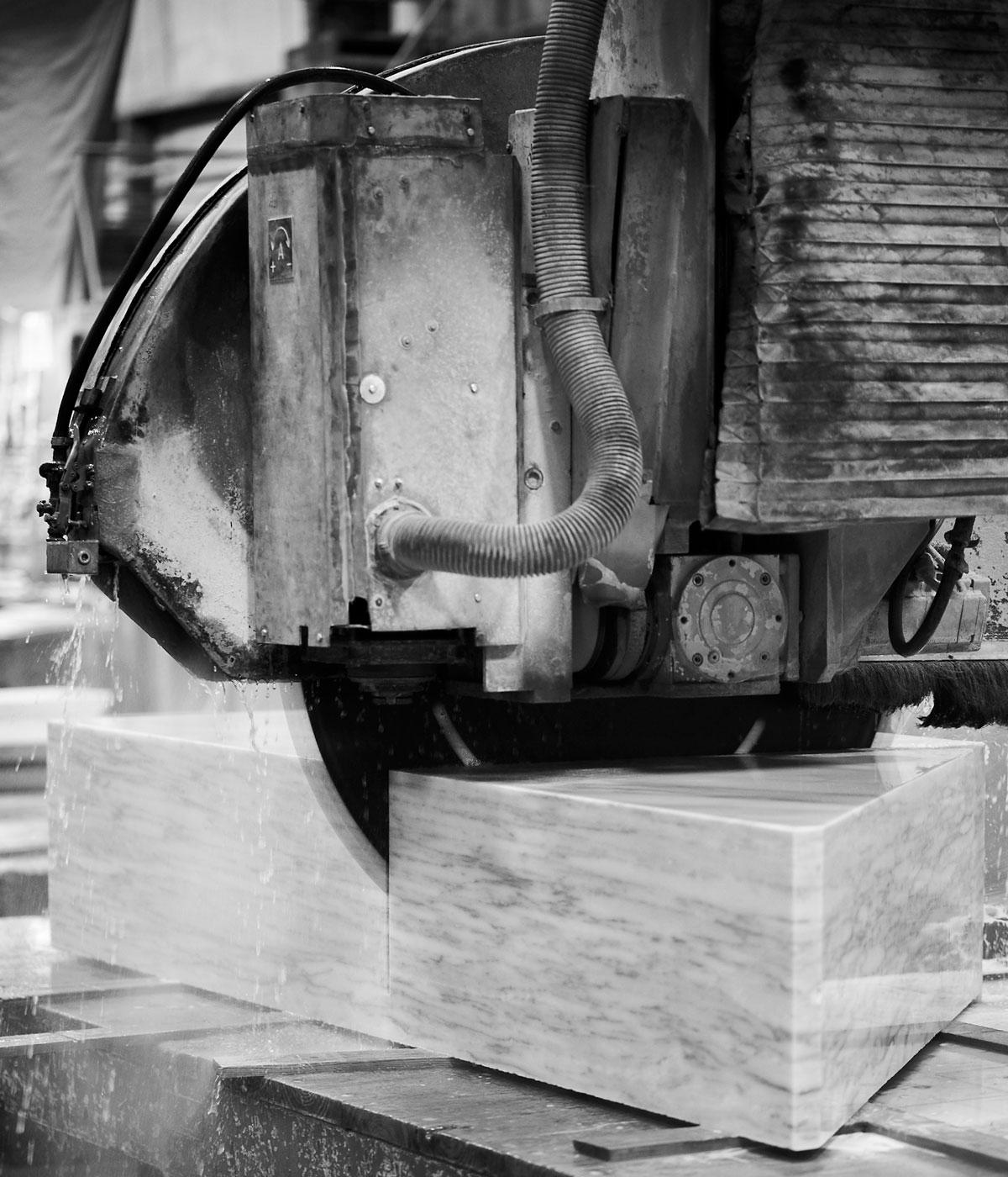 Black and white inage of a machine cutting marble