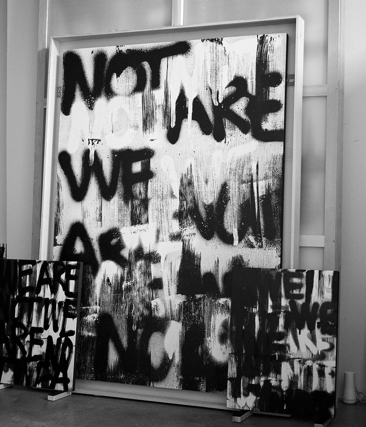 black and white picture of spray painting words