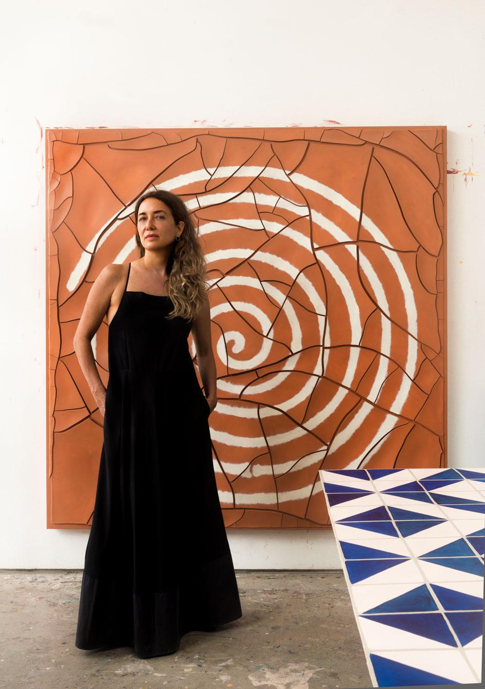 Adriana Varejão stands in front of her new painting, Espiral [Spiral], 2020.Photography: Vicente de Mello.Courtesy the artist and Gagosian