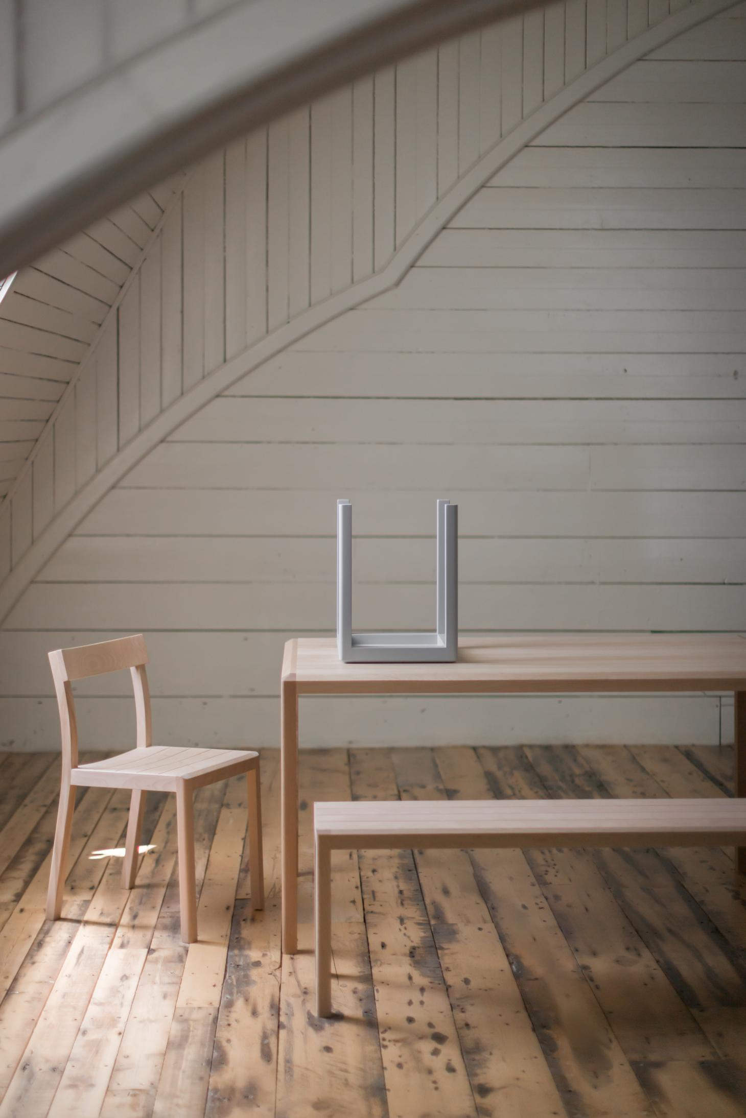 Furniture by Anthony Guex for Fogo Island Inn including wooden armchair, table and bench