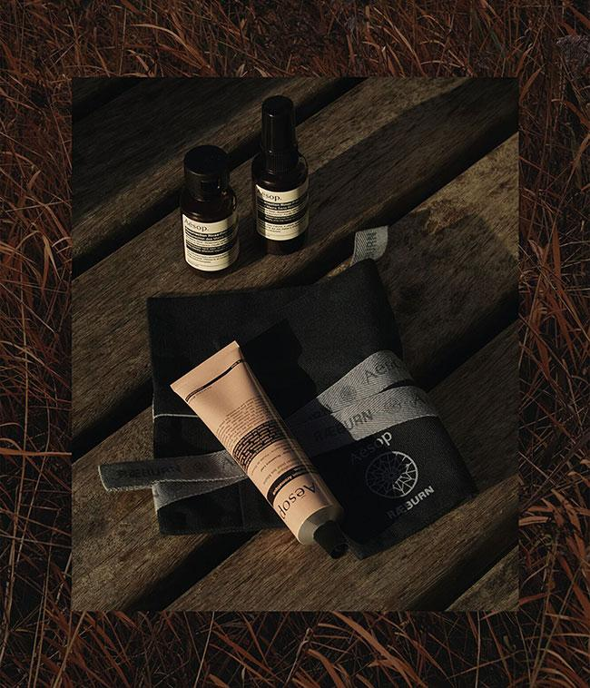 aesop and raeburn roll-up next to aesop products in brown bottles