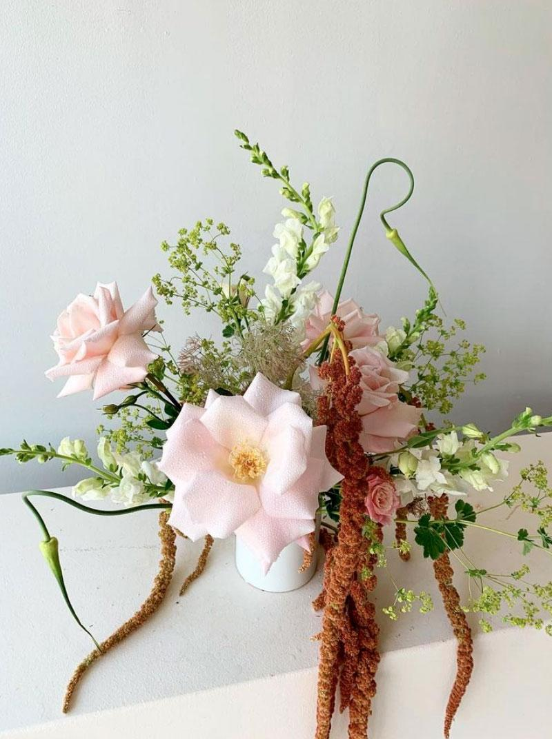 Bouquet by Miami florist Calma featuring big light pink flowers surrounding by smaller pink and white flowers