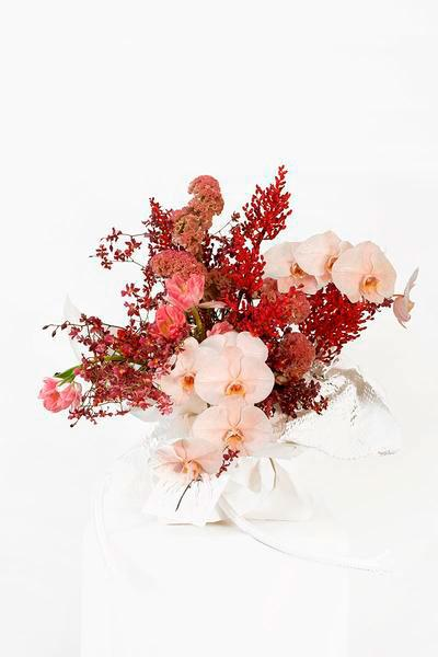 Singapore florist Humid House bouquet made of pink and flowers against white background