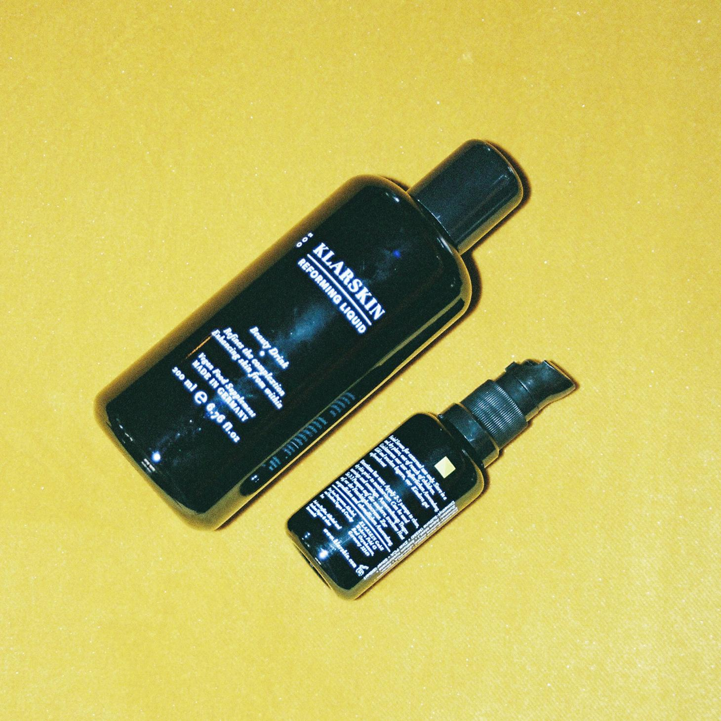 black KLARSKIN bottles against bright yellow background