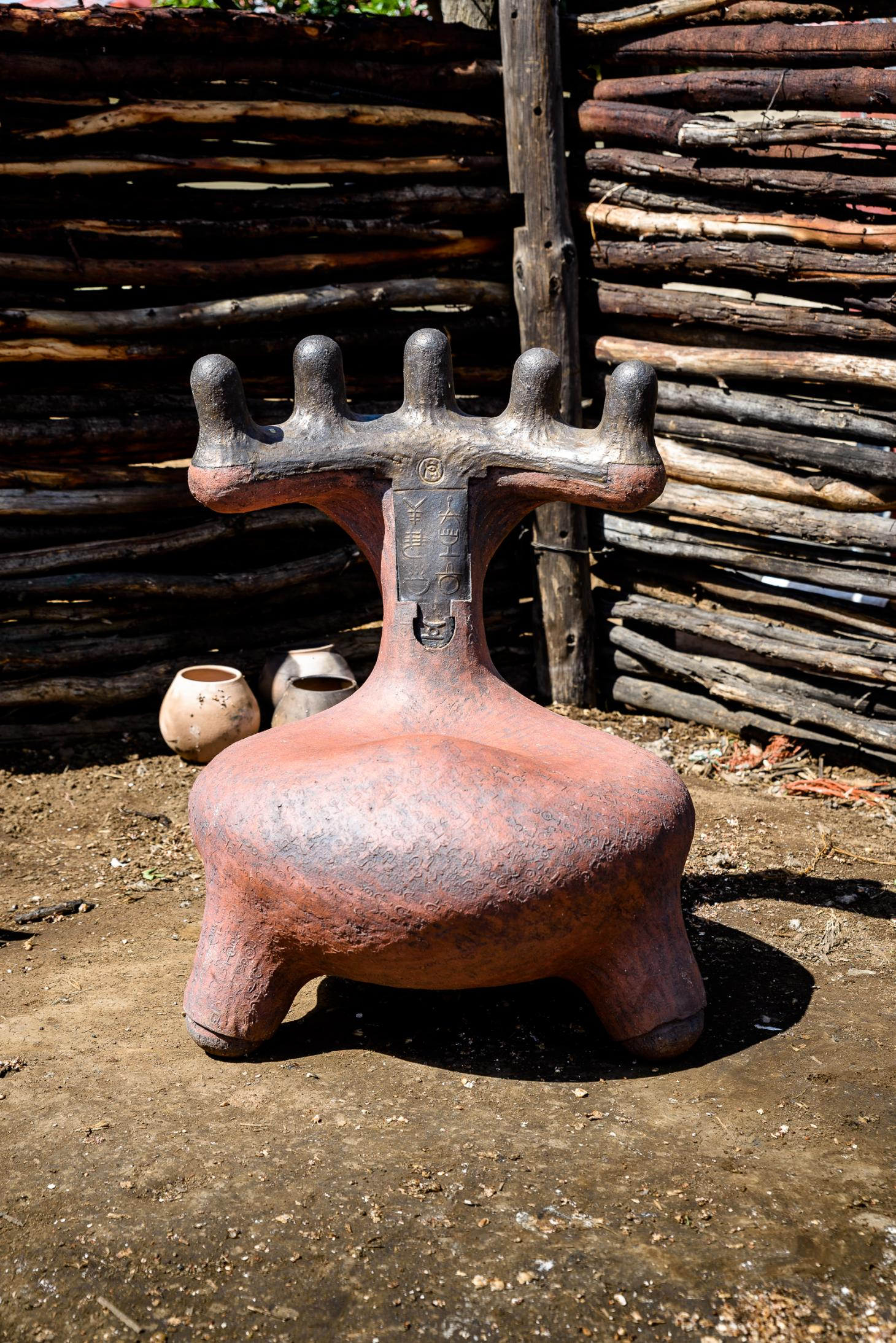 Clay seat by African designer Andile Dyalvane photographed outdoors at the village of Ngobozana, Eastern Cape