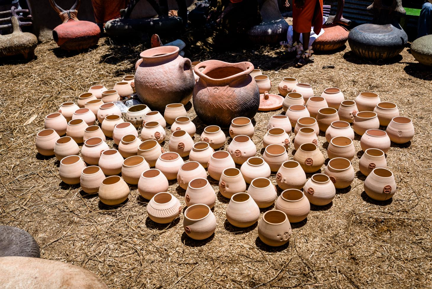 Traditional Xhosa clay vessels photographed outside at Ngobozana, Eastern Cape