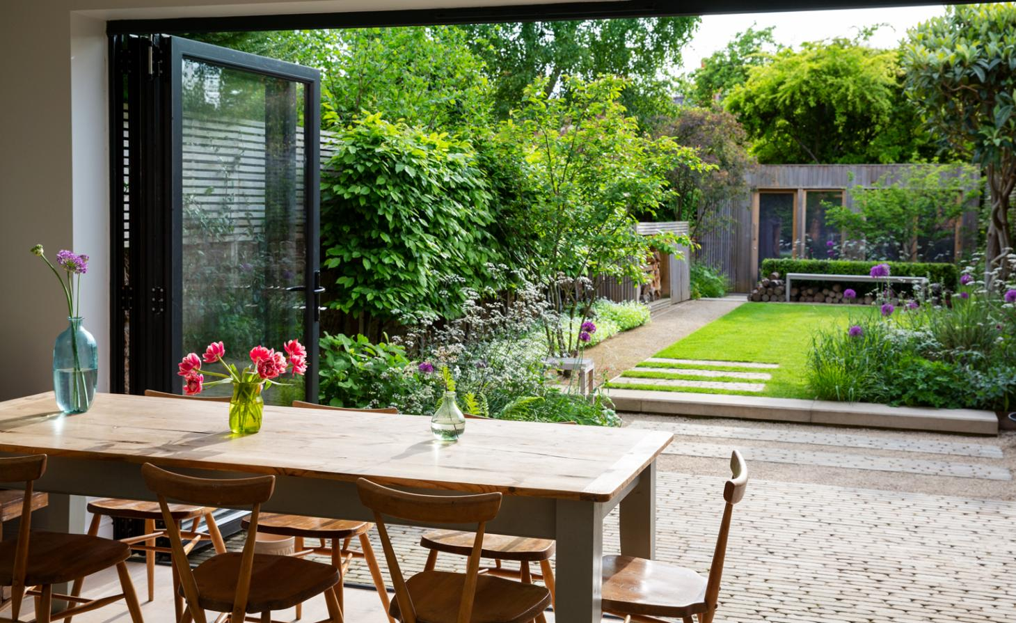 Small garden with seating area and wild flowers